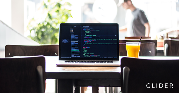 An open laptop on a table (Front End Web Developer Interview Questions)