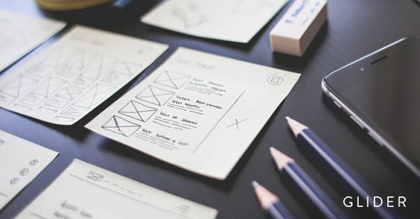 Sticky notes with checklists , pencils, erasers and a cellphone on a table (UX Designer Interview Questions)